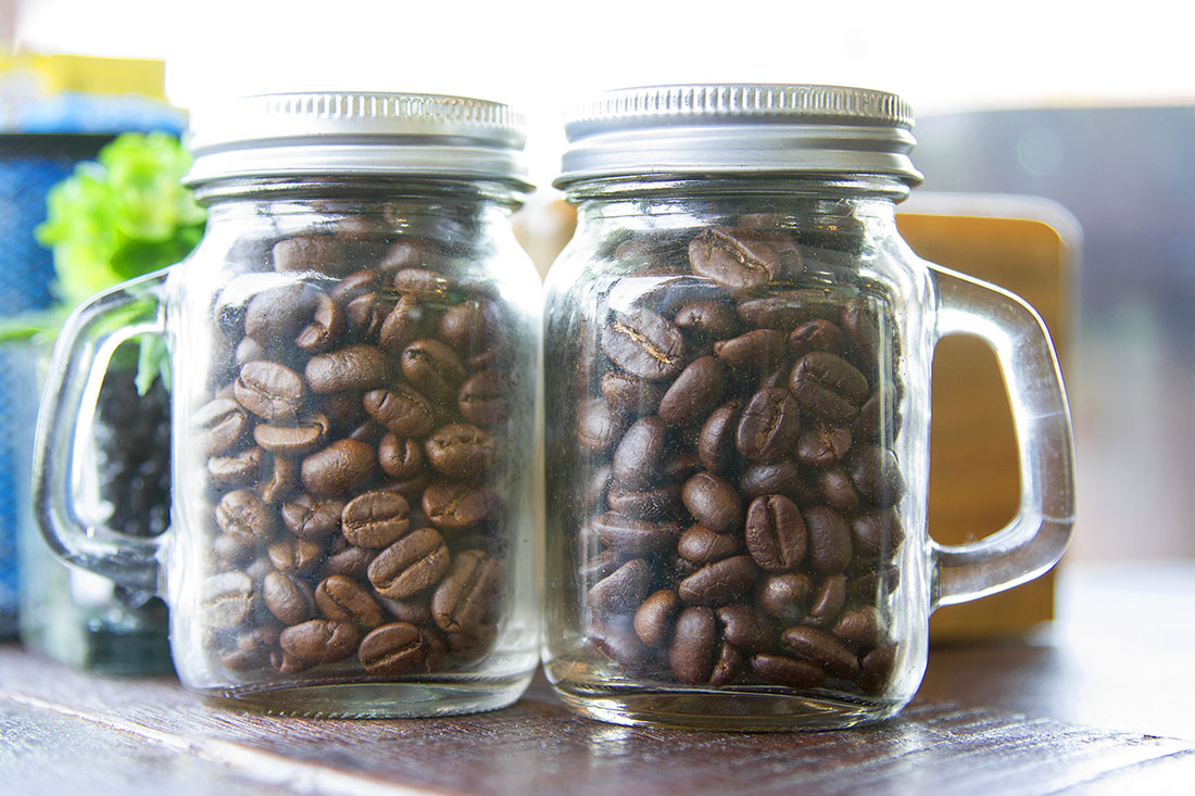 Coffee beans in two bottles placed on the table