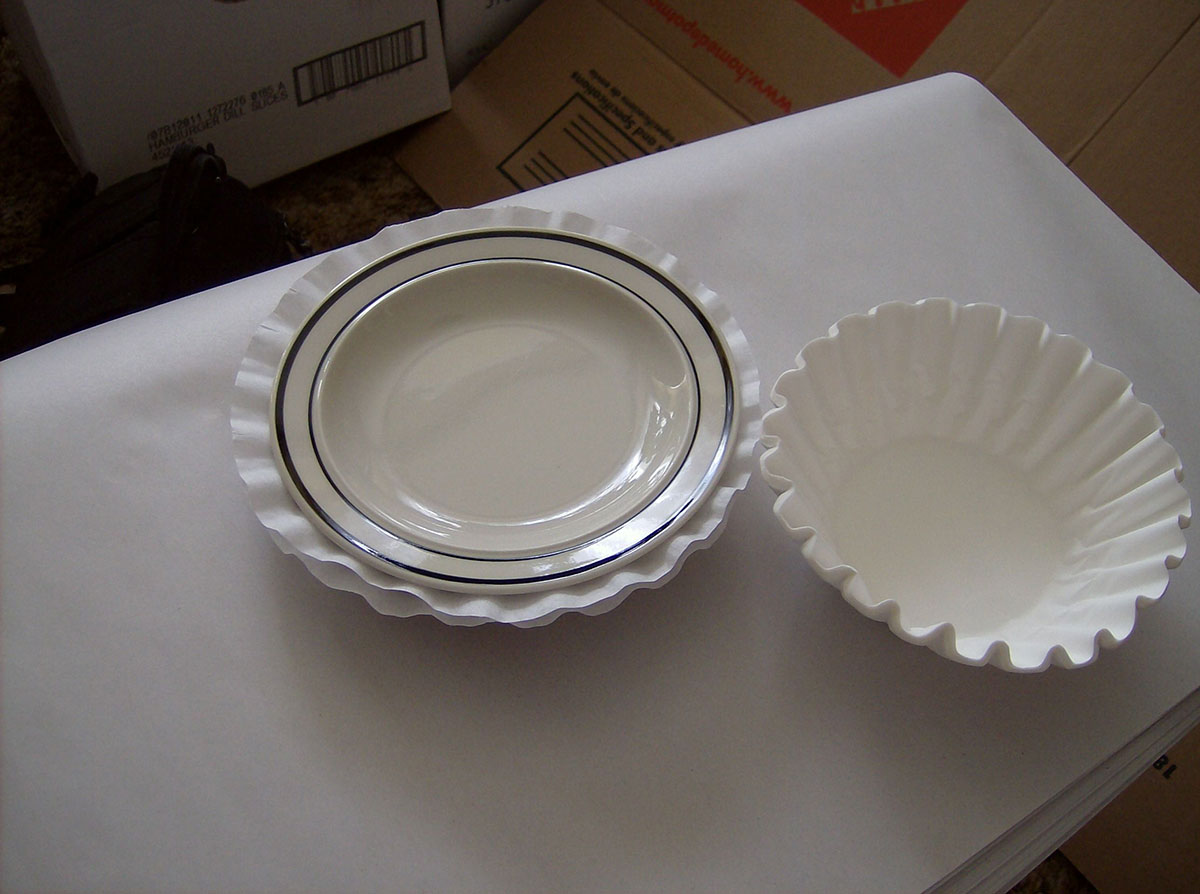 use coffee filters to protect small plates and bowls from scratching