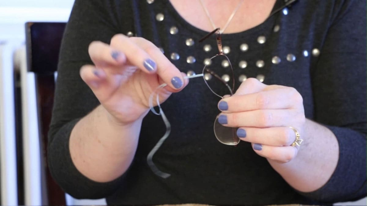 Woman putting floss in glasses