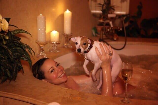 Mariah Carey and her dog in a bathtub