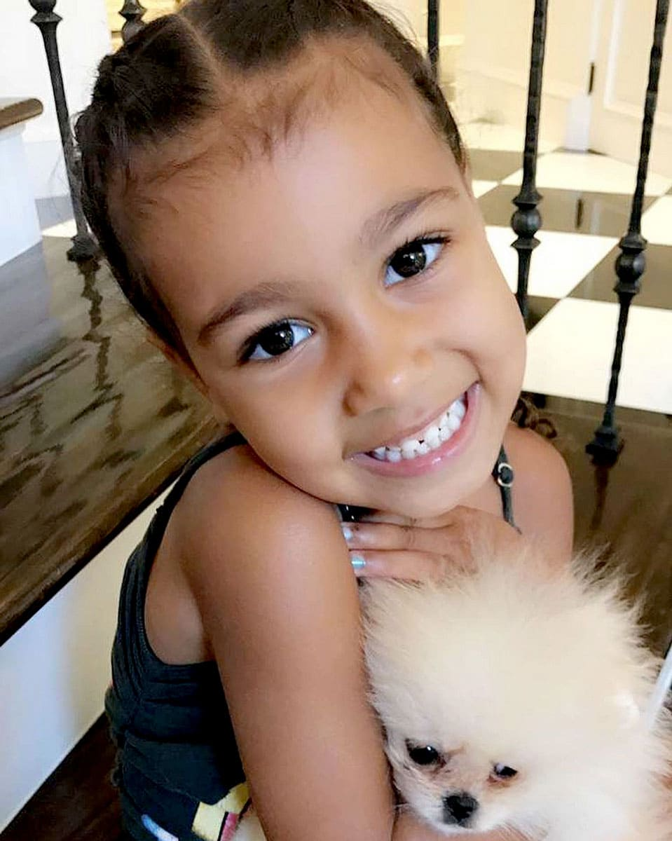North West with her dog Sushi