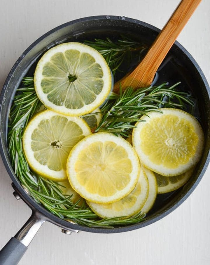 Lemons and rosemary in a pot