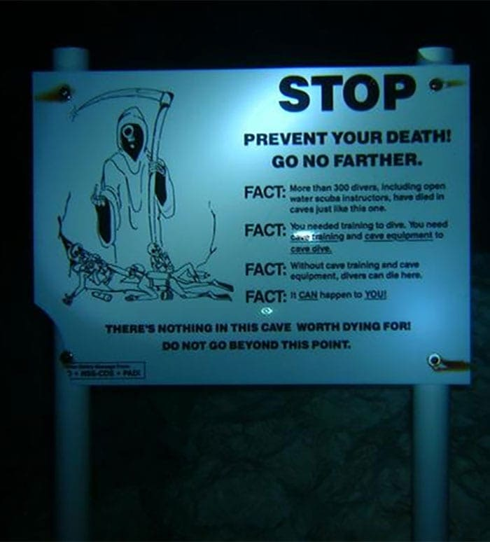 "A sign underwater that reads ""STOP, prevent your death! Go no farther."""