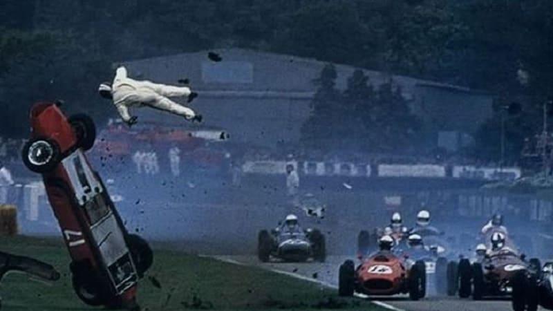 Racecar driver flying mid-air in a car crash