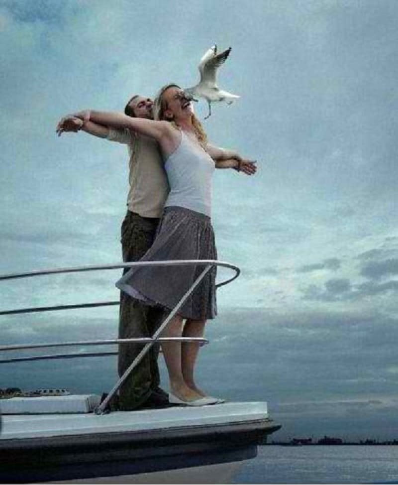 A bird flying into the face of a woman