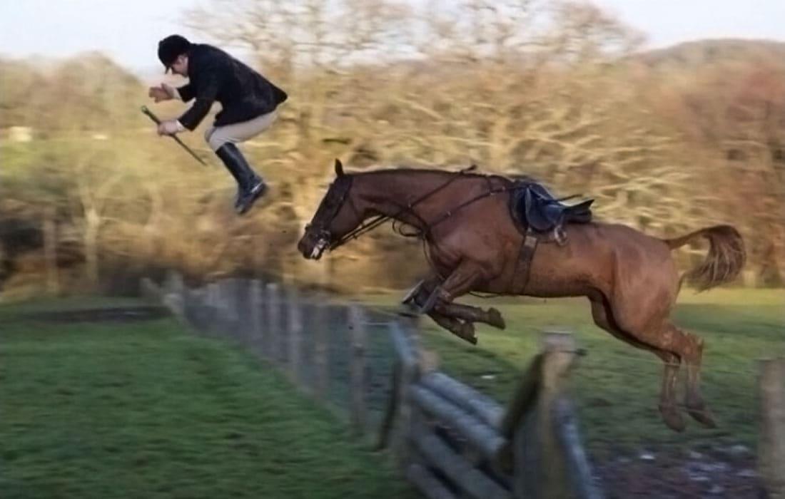 A jockey thrown off his horse