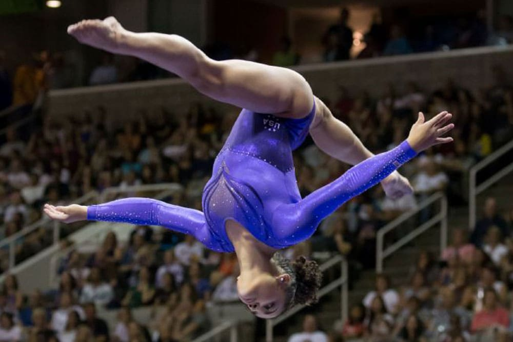 Gymnast jumping upside down