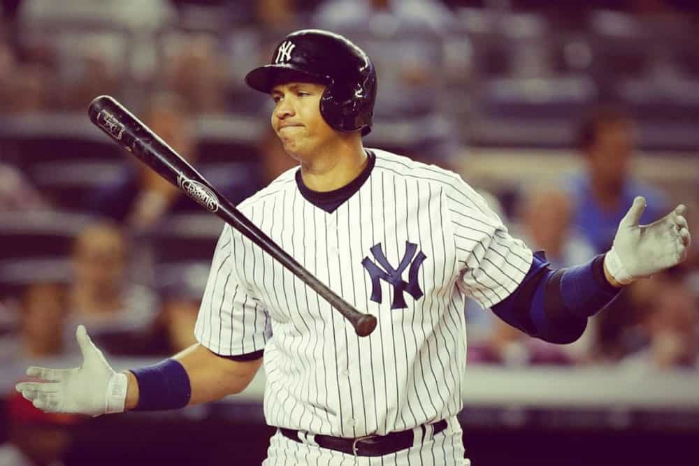 Alex Rodriguez tossing up the baseball bat