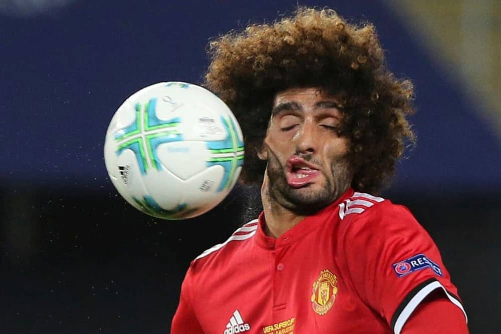 Soccer player getting the ball to this face