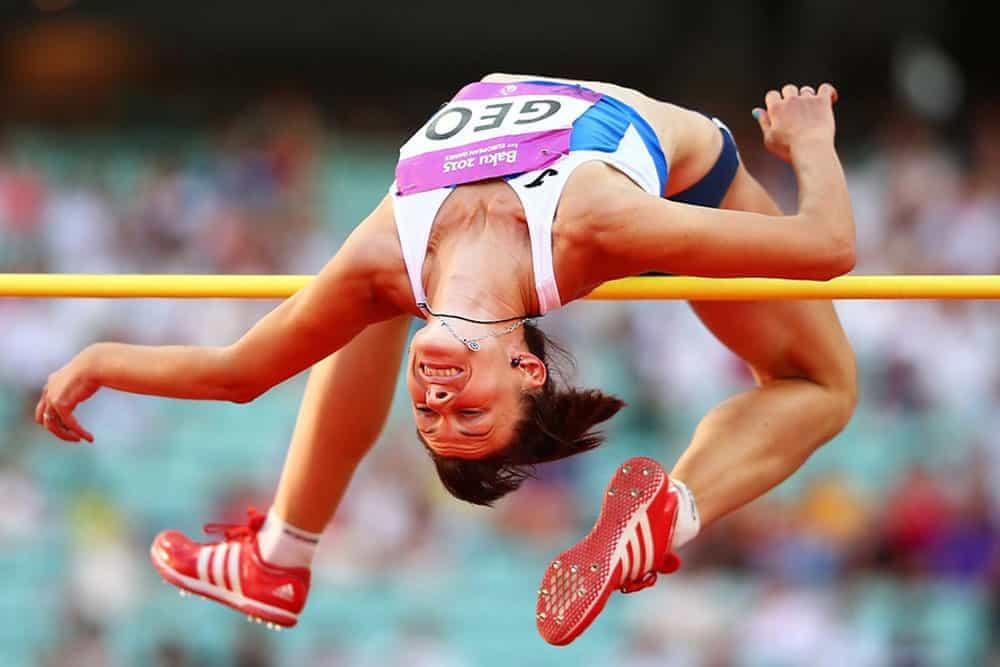 High jumper jumping over a beam