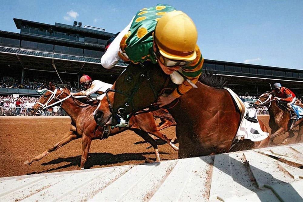Jockey falling off his horse