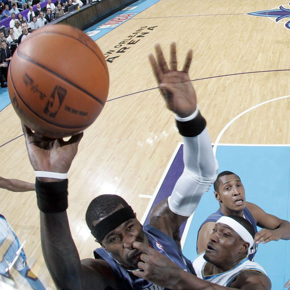 A basketball player making a slam dunk