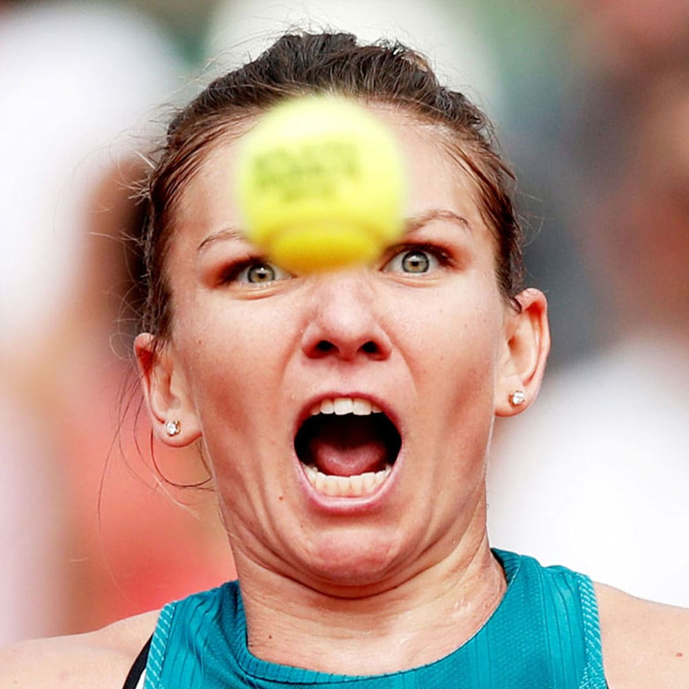 Simona Halep with a tennis ball in front of her