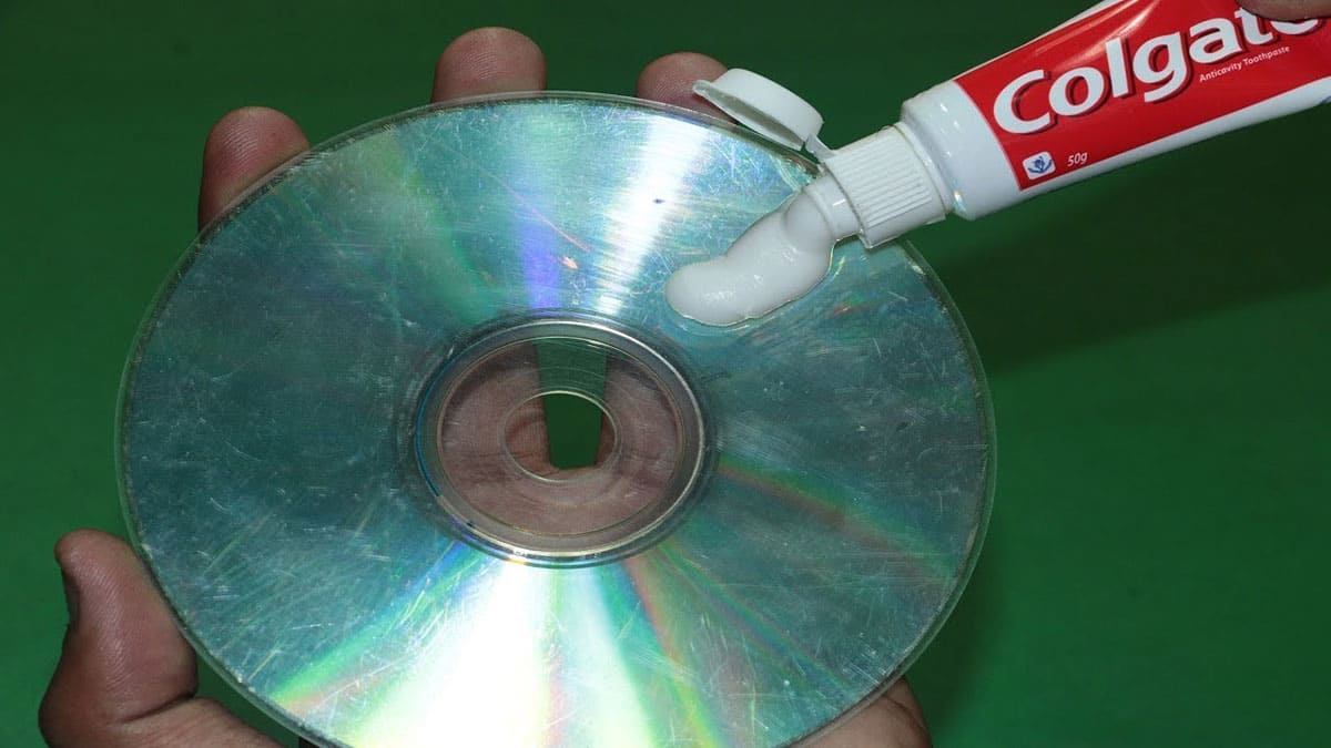 Applying toothpaste to a scratched CD