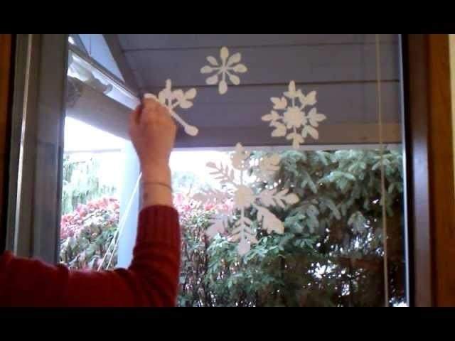 painting winter decorations on the window