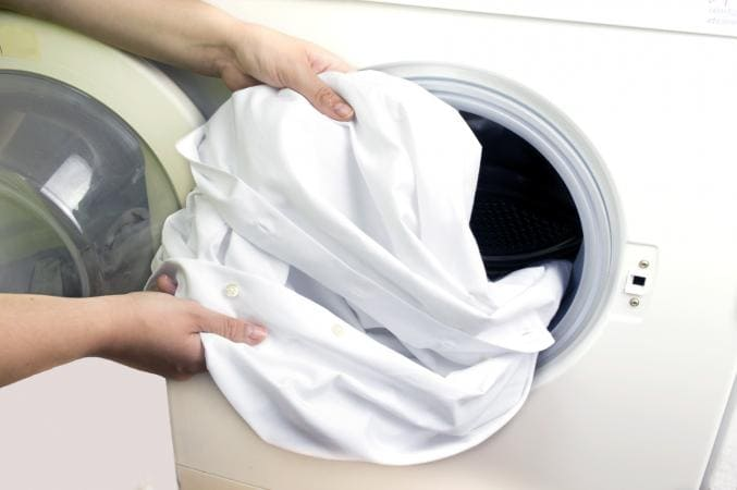 A clean white shirt coming out of the washing machine
