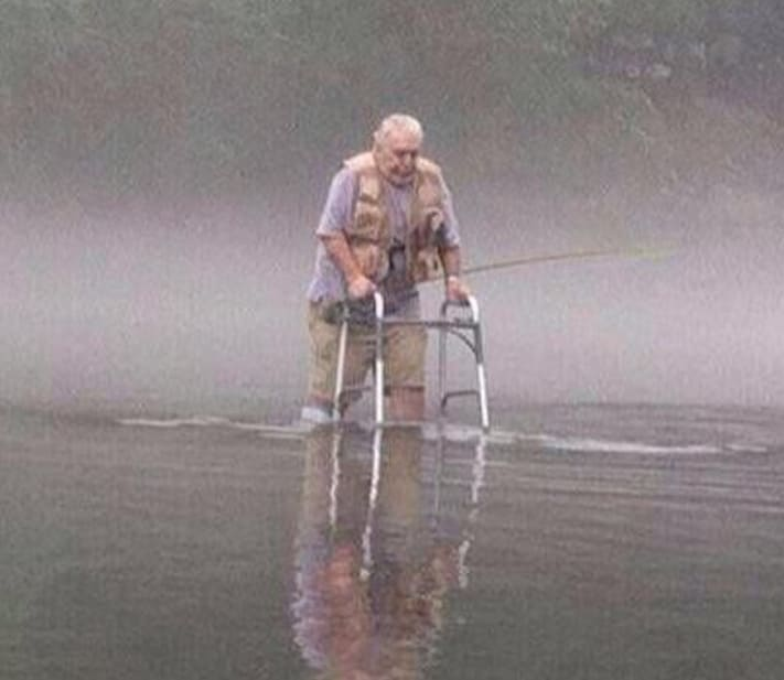 An old man fishing in the lake