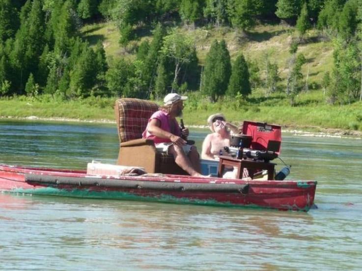 A man sitting on a sofa in a boat