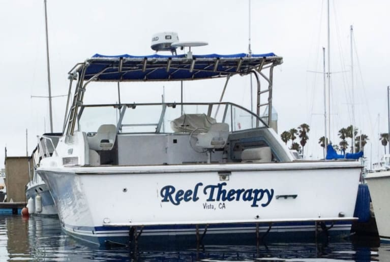"""A boat that says """"Reel Therapy"""""""