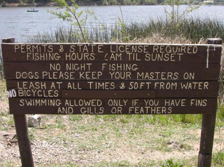 A sign on the lake