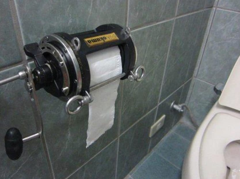 A fishing rod toilet paper holder