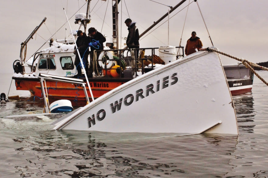 """A sinking boat that says """"No Worries"""""""