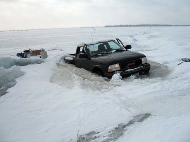 A truck sinking in melting ice
