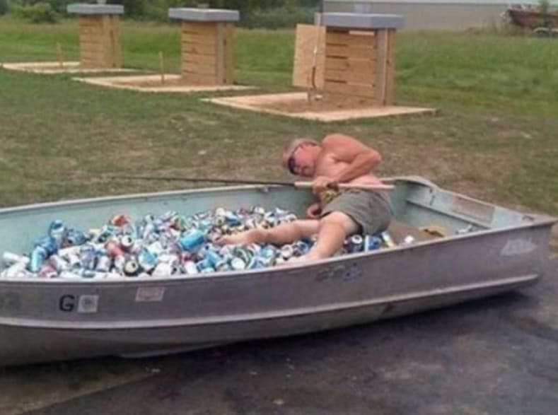 A man in a boat full of cans