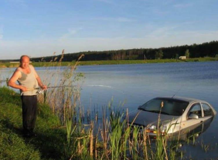 A man fishing a car