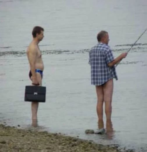 Two guys on the beach not wearing pants