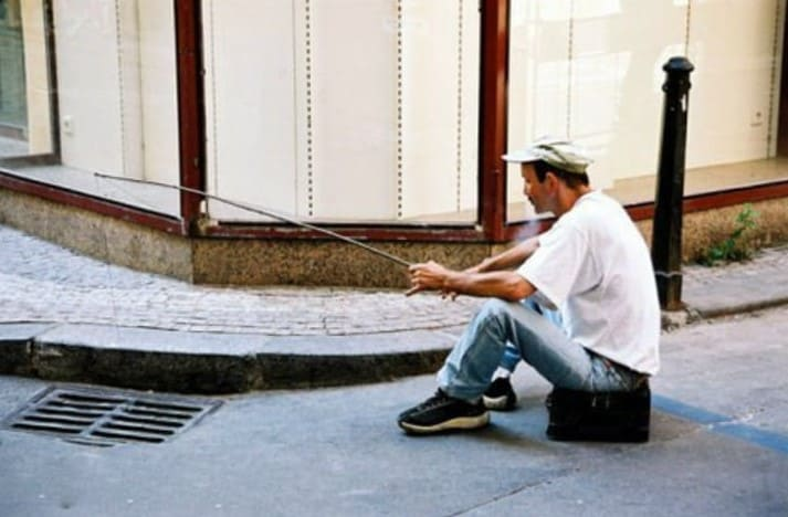 A man fishing in the sewer
