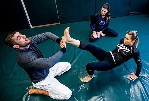 Heidi working out with Rener Gracie