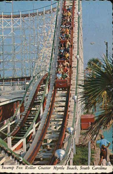 People riding the Swamp Fox in family kingdom