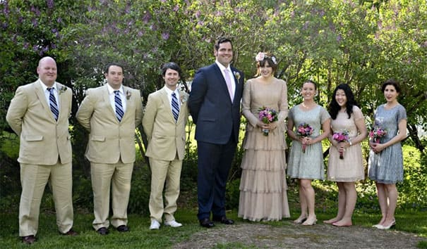 The tall groom and his short groomsmen, a tall wife, and her short bridesmaids.
