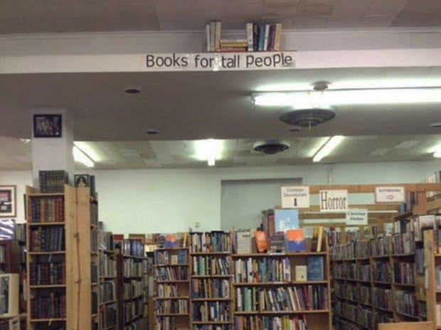 A separate section in the library, touching the roof is a stash of books for tall people