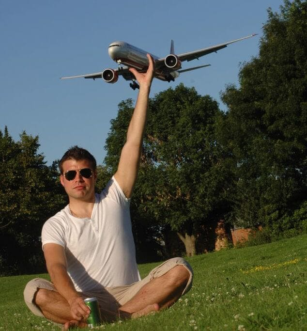 Man holding an airplane