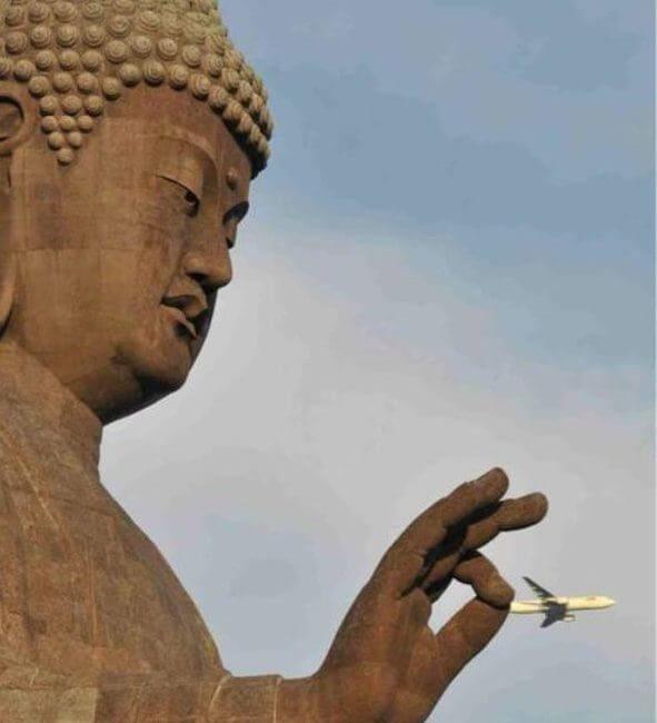 Buddha seemingly pinching an airplane
