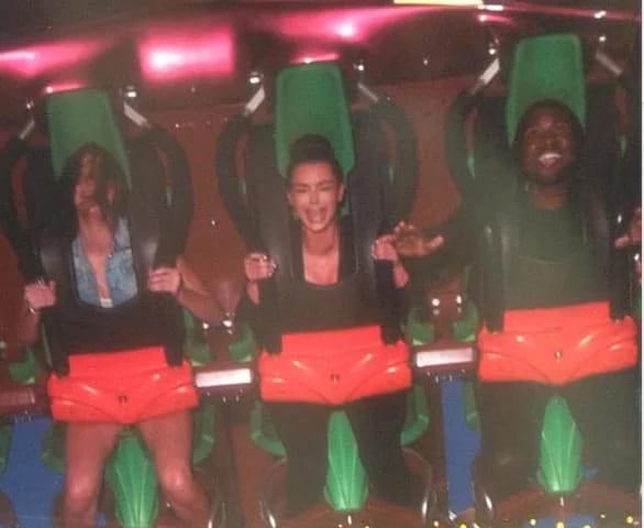 Kim Kardashian and Kanye West on a roller coaster