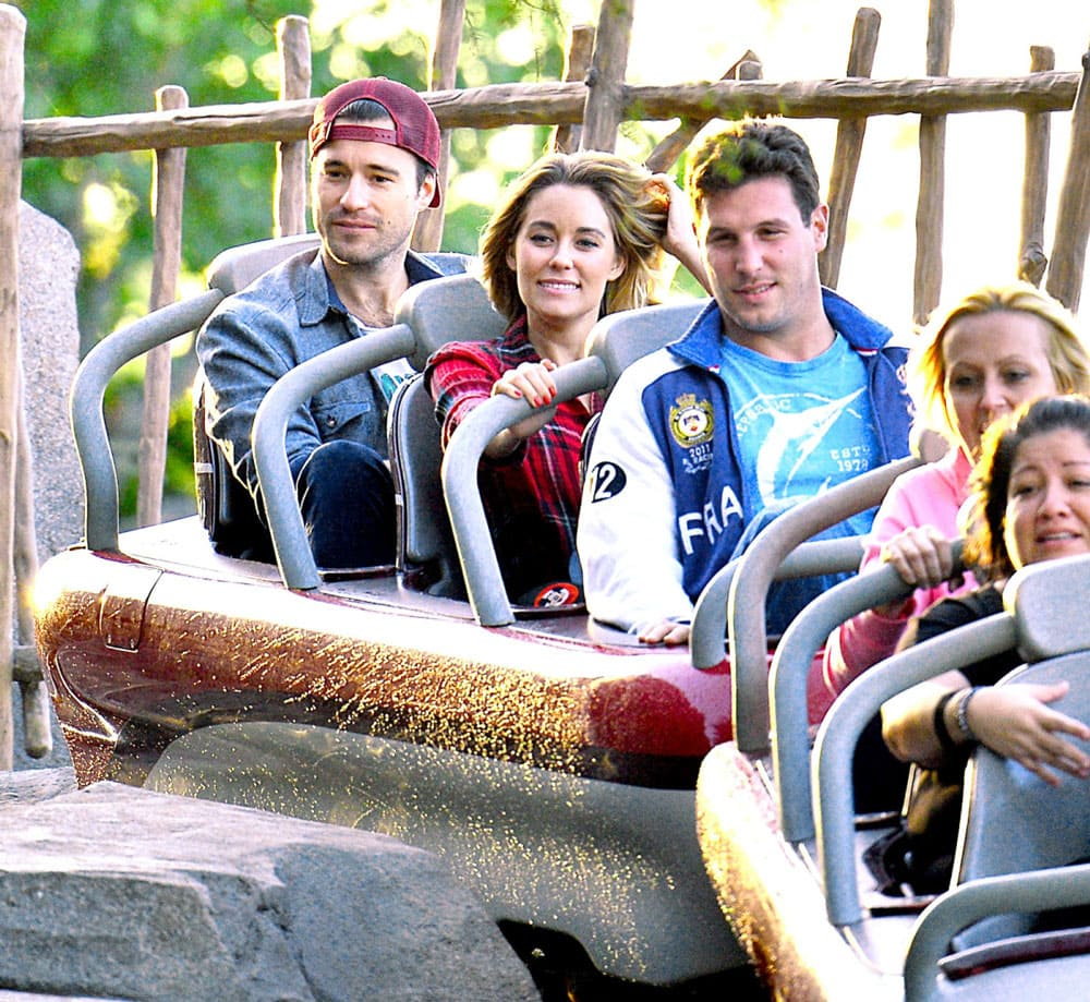 William Tell and Lauren Conrad on a roller coaster