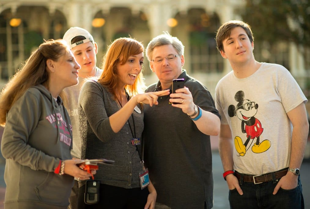 Disney's guests showing a photo