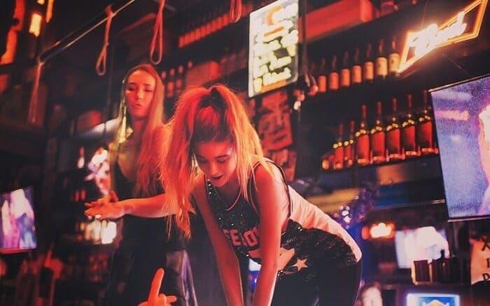 A female bartender is enjoying Moscow nightlife.