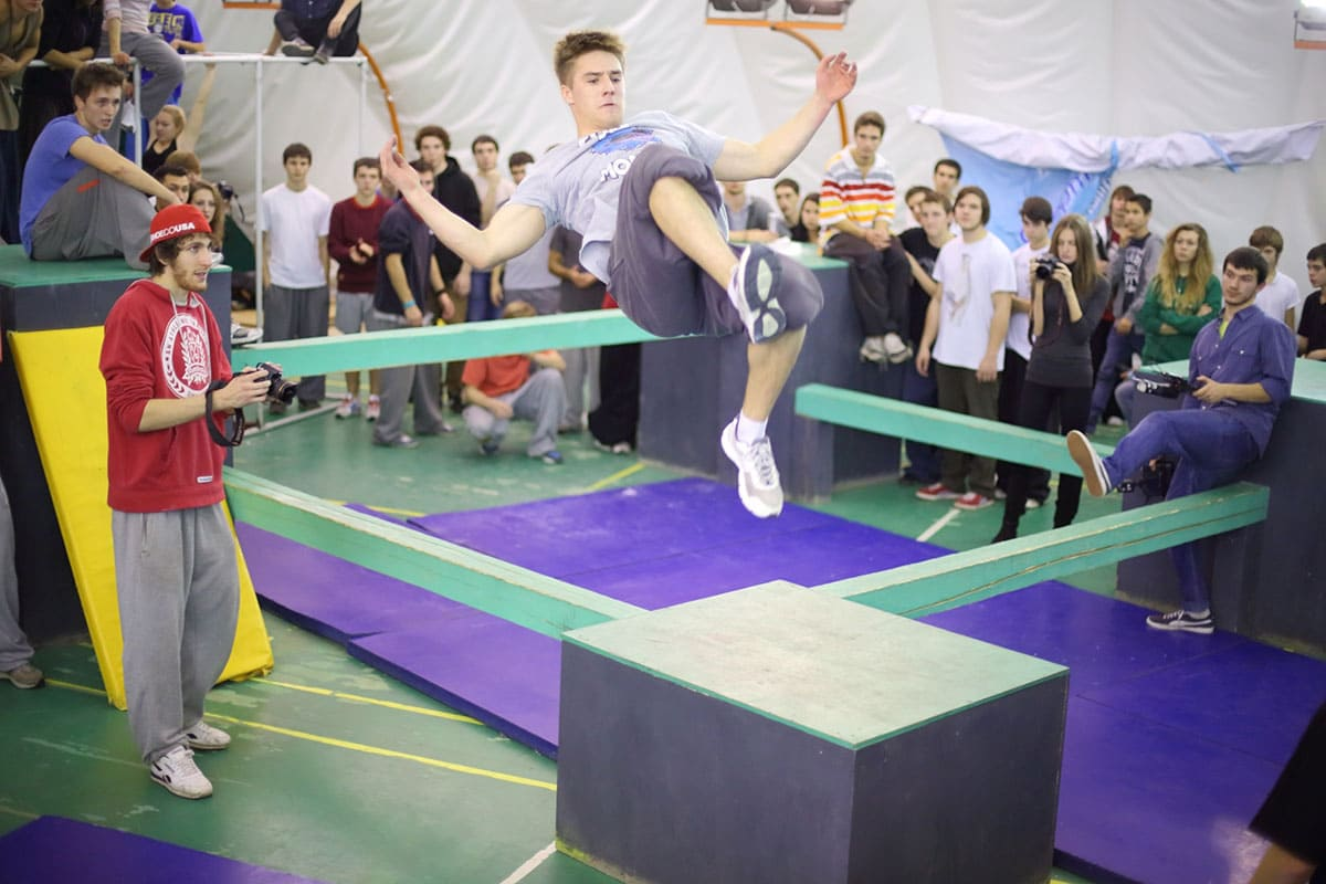 A man in a jump on the 5th parkour contest to move at the University of Physical Education, Max Attack: Death Circle, on Nov 17, 2012, in Moscow, Russia.