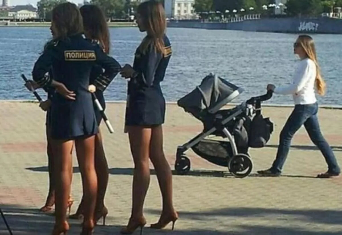A few female police officers in Russia dressed in short skirts and four-inch stilettos while holding batons.