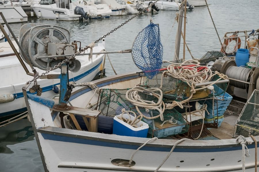 Close up of a fishing boat in the port with fishing gear and equipment.