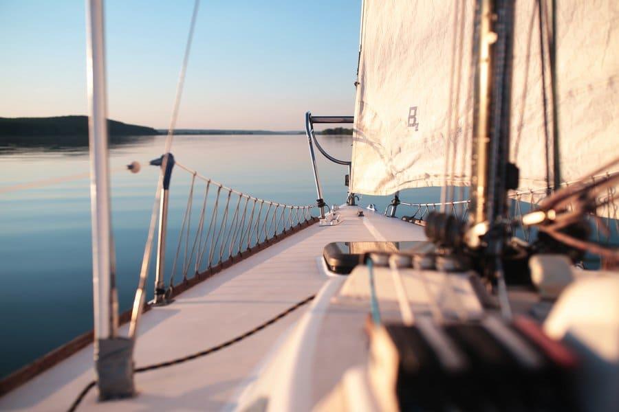 Photograph of a small boat sailing along.