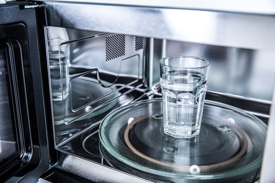Inside view of a glass of water in the microwave.