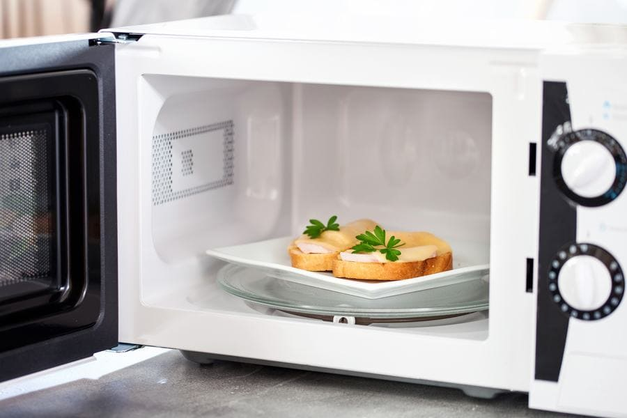 Photograph of sandwiches in the microwave.
