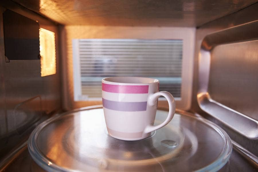 Photograph of a mug sitting in the microwave.