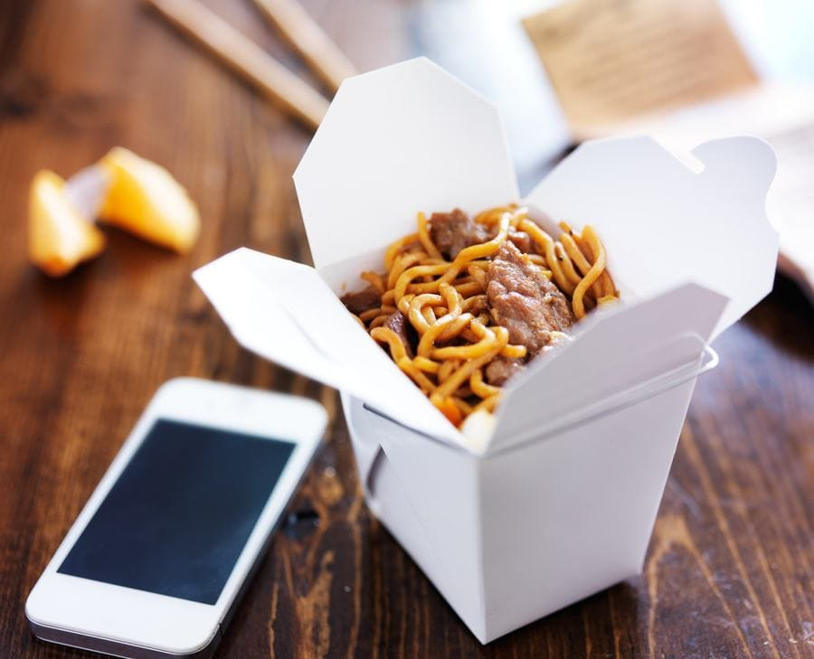 Chinese food take out in the white square container