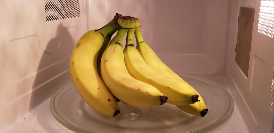 Photograph of bananas sitting in the microwave.